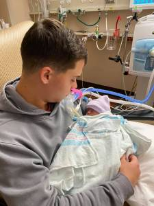 picture of Brandon and baby mac at the hospital